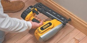 nailing baseboard with nail gun